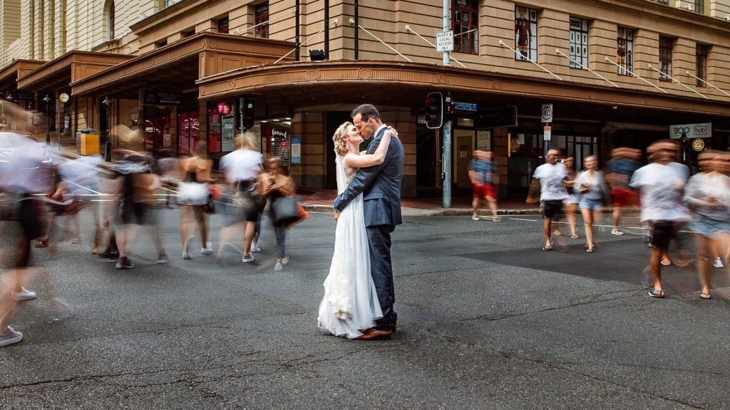 bride-and-groom-street-crossing-kiss-1