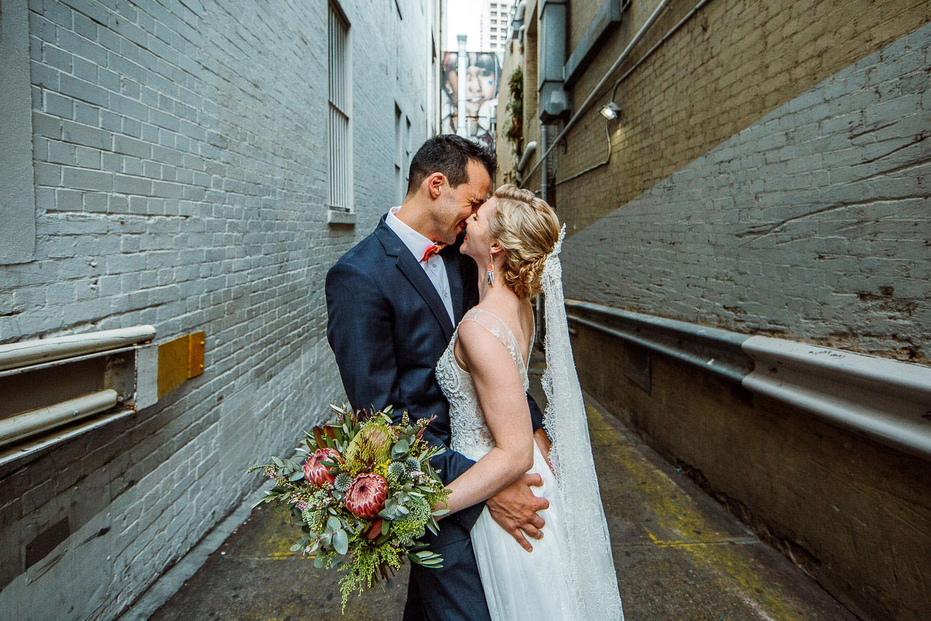Bride and groom kissing in Brisbane lane way