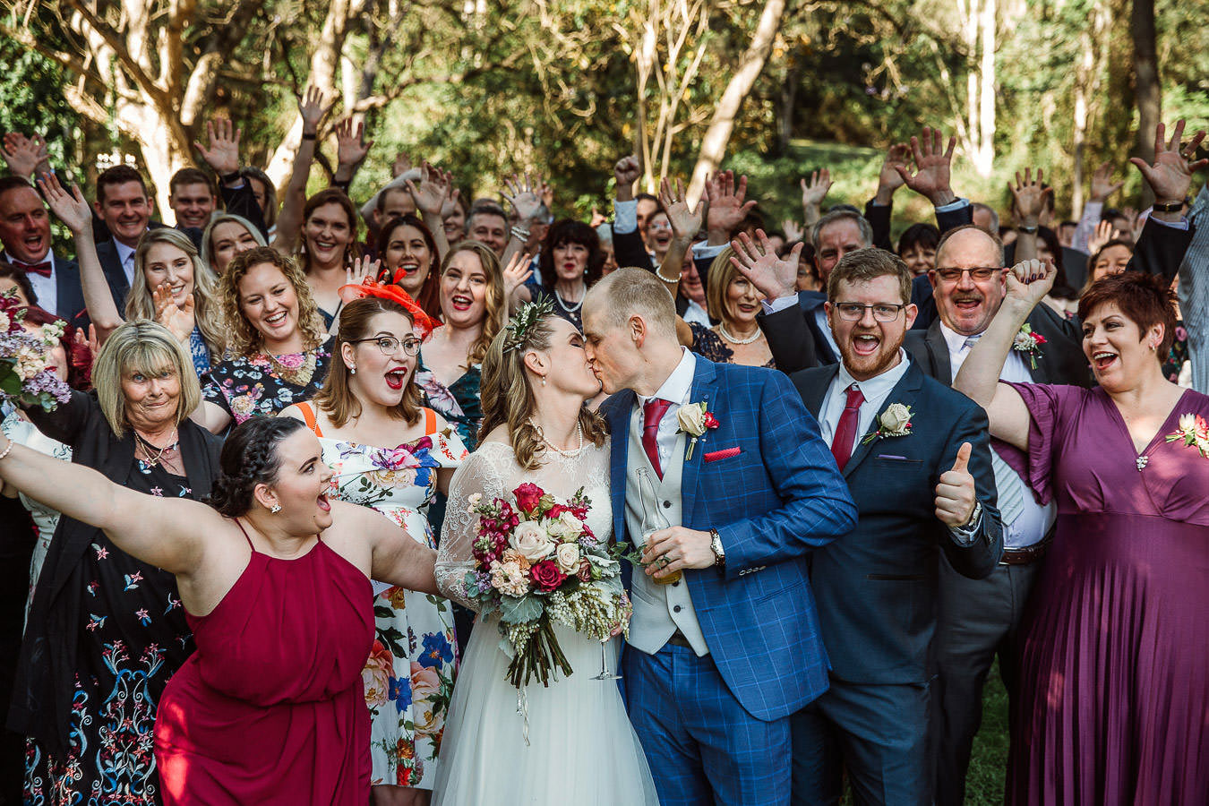 wedding-kiss-in-group-photo