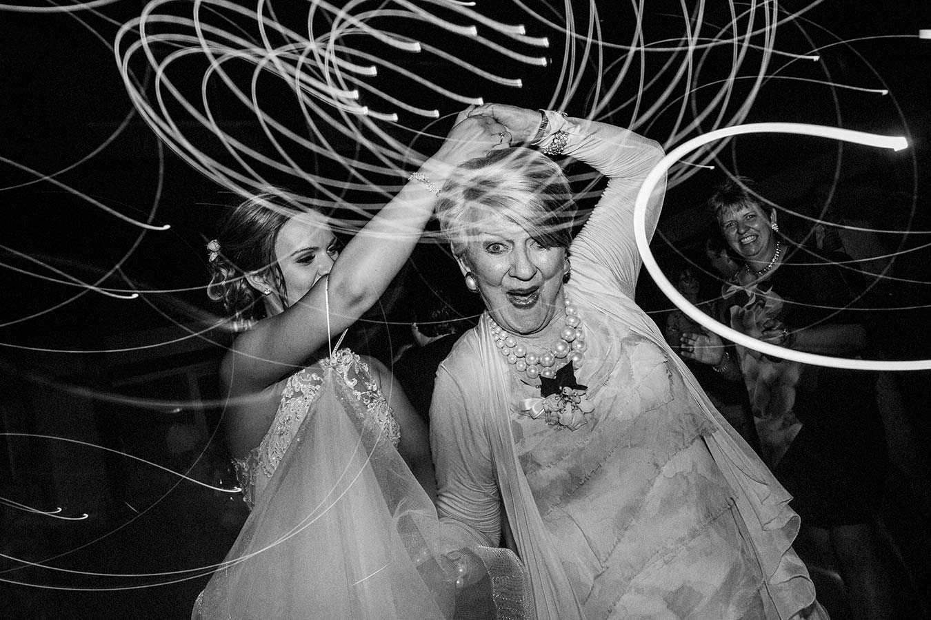bride and grandmother dancing
